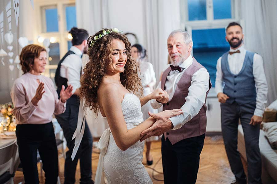 Do the wedding dances in the traditional order.